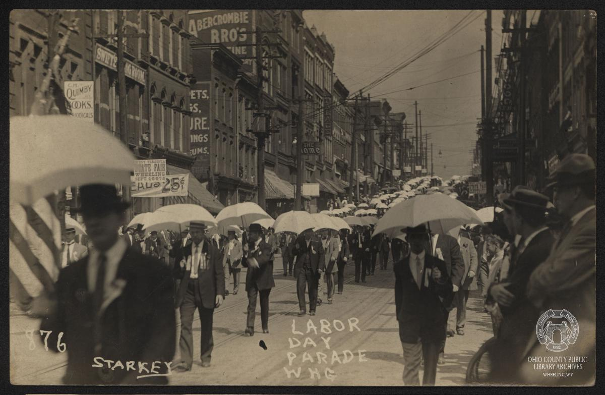 Real photo postcard of a Labor Day Parade on Main Street in Wheeling in 1907.