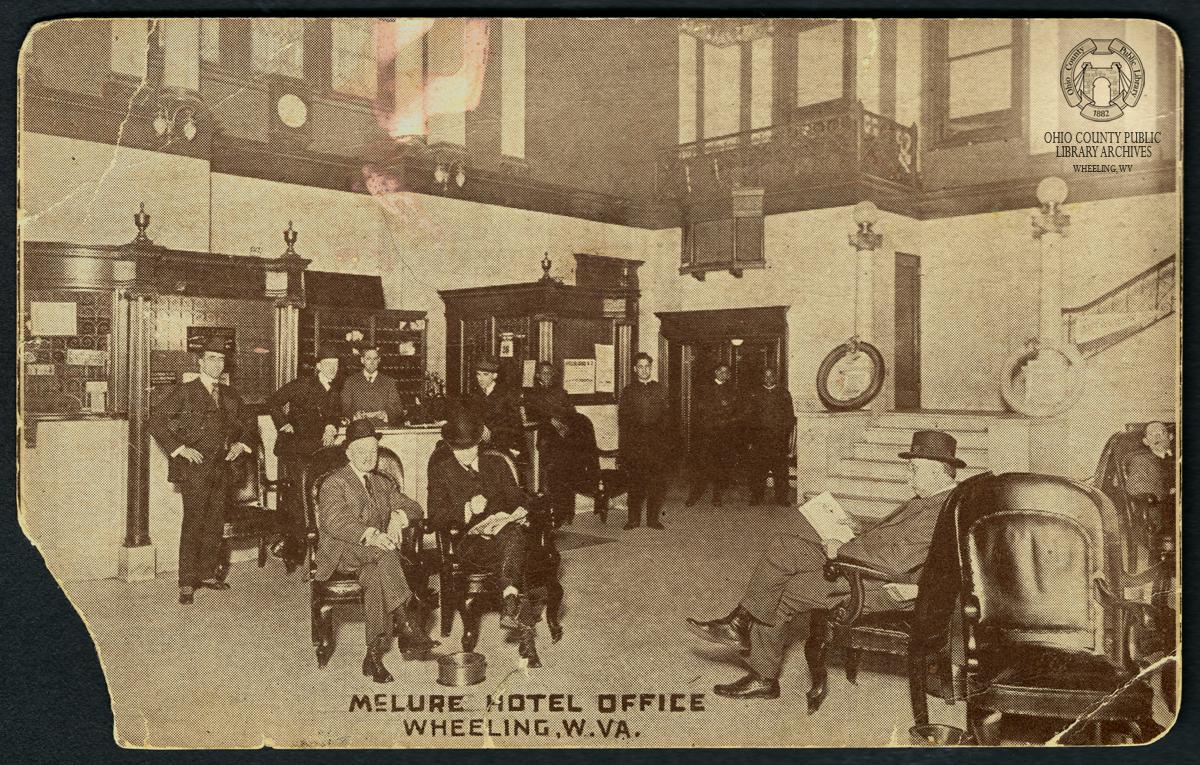 McLure Hotel Postcard showing black men as porters.