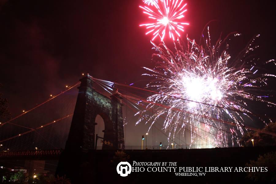 Fireworks over the Suspension Bridge, July Fourth, 2013.