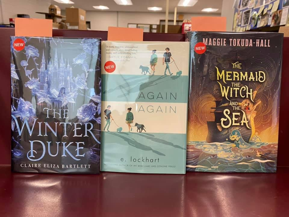 New Young Adult Books Available for curbside pick-up at the Library - The Winter Duke by Claire Eliza Bartlett, Again Again by E. Lockhart, The Mermaid, The Witch, and the Sea by Maggie Tokuda-Hall