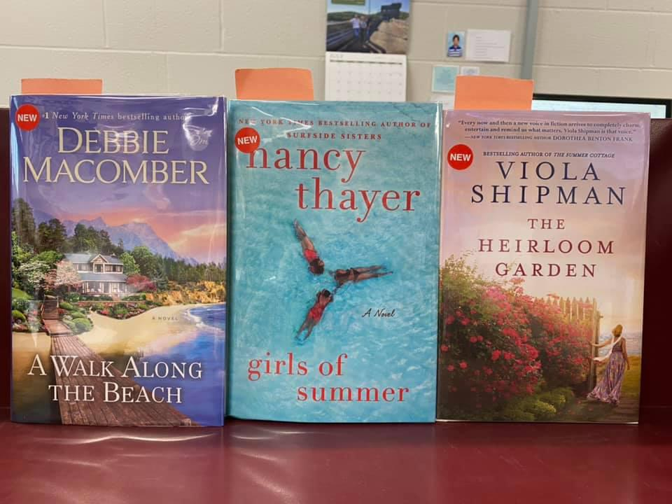 New Romance Available for curbside pick-up at the Library - A Walk Along the Beach by Debbie Macomber, Girls of Summer by Nancy Thayer, The Heirloom Garden by Viola Shipman
