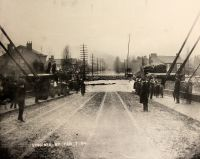 The Island end of the Suspension Bridge, looking straight down Virginia Street, during the flood of 1884 which reached the unprecedented stage of 52 feet.