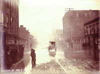 The flood of 1884 showing Market Street at 14th. The Pollock Flour Mill, the four story building in the center, stands on the present day sight of the Central Union building.