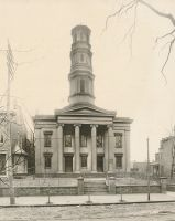 The First Presbyterian Church located between 12th and 14th on Chapline Street. It was built in 1825 and still stands although the steeple has been removed.