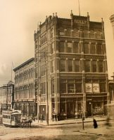 The old Opera House was erected in 1873. Many famous actors and singers appeared here. The Reilly building stands out front on this corner, 14th and Market Streets. It was built in 1886. Note the mule team hitched to the street car coming around the corner.