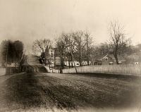 A spring view of National Road at Mount Calvary, looking east showing Stamm House at the top of the hill.