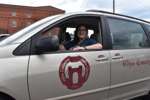 Outreach Services Specialist in library van. Photo by Eric Ayers