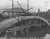 W.C. Brown Photo #76: Placing the keystone at Main Street Bridge