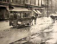 Martin's Ferry and Benwood Ferry in a rainstorm on Market Street near 12th when horse cars were the principle public transportation. Notice the flagstone walks and muddy streets. This was Wheeling in 1885.