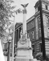 Augustus Pollack monument at its original location on 16th Street near the old city building, 1949. OCPL Archives.