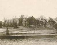Monument Place, Elm Grove, showing the old stone barn and the roof of the slave quarters.