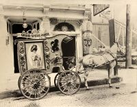 The advertising wagon and the beautiful white horse of the Grand Opera House.